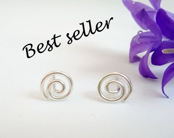 Small silver spiral stud earrings, UK, sterling silver, hand formed.