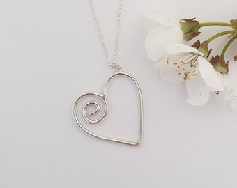 Silver heart pendant necklace, spiral, girl, sterling silver, hand-shaped