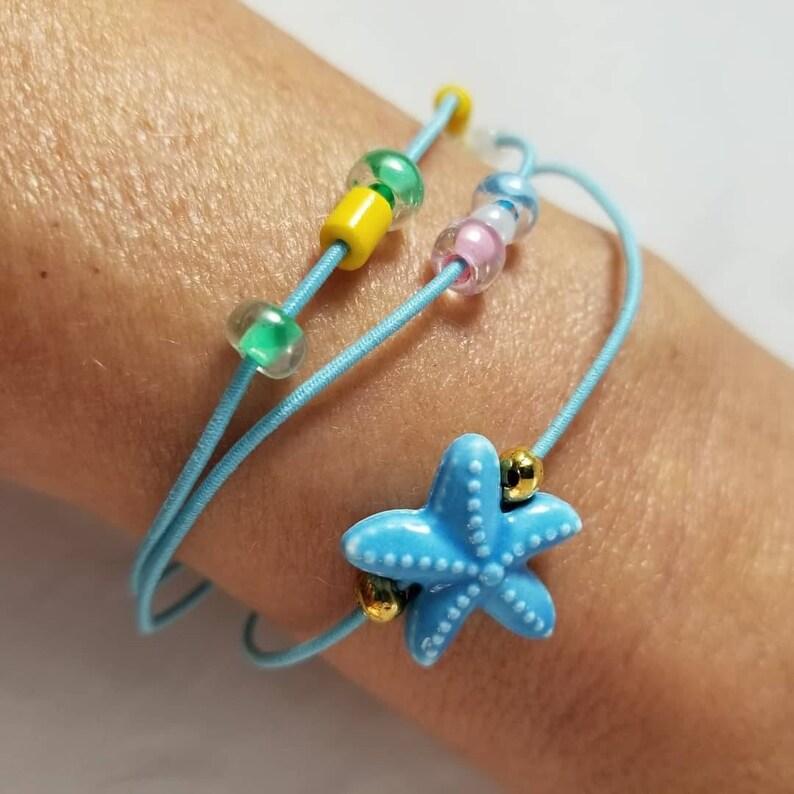 Blue Starfish Glass Bead Three Strand Stretch Blue Cord image 0