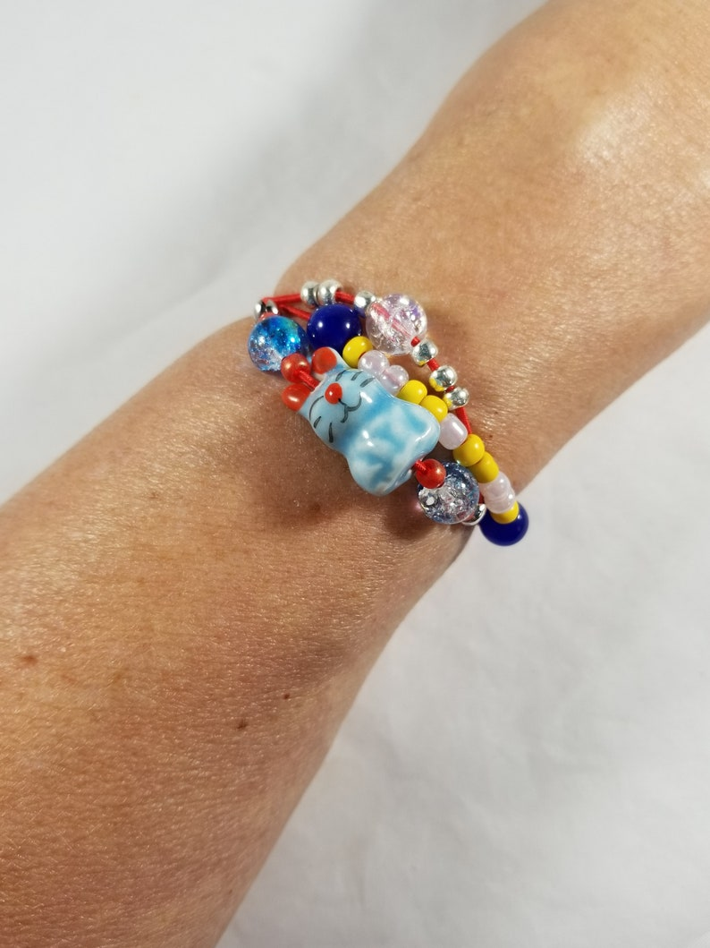 Blue Bunny Ceramic Beaded Bracelet Three Strand Red Stretch image 0