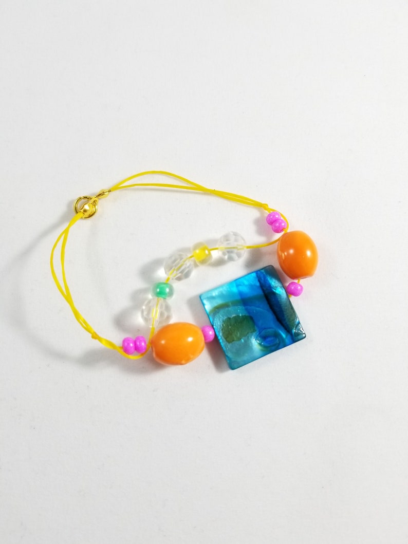 Blue Glass and Orange Beaded Bracelet Stretch Yellow Cord image 0