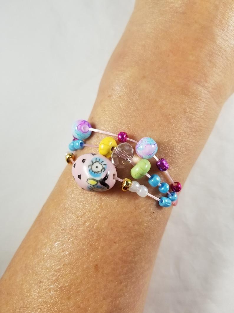 Pink Ceramic Owl Beaded Bracelet Three Strands Pink Stretch image 0