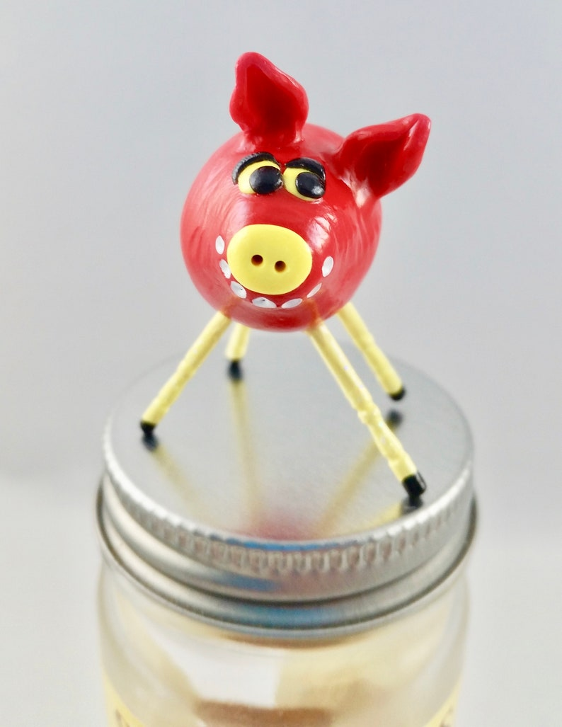 Mini Smiling Clay Pig Red with Clay Smiley Face and Yellow image 0