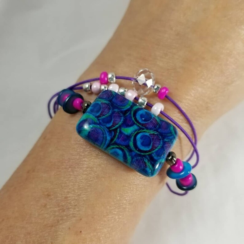 Peacock Ceramic Bead Bracelet Stretch Purple Cord image 0