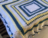 Blue, white and yellow large crochet blanket