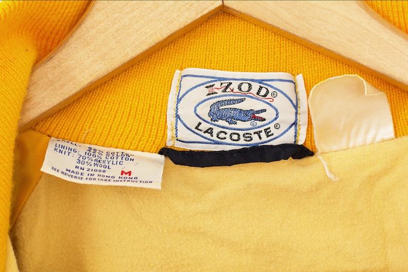 8f6a85e91783f Anorak Izod Lacoste bleu et jaune. Coupe-vent Izod Lacoste vintage.