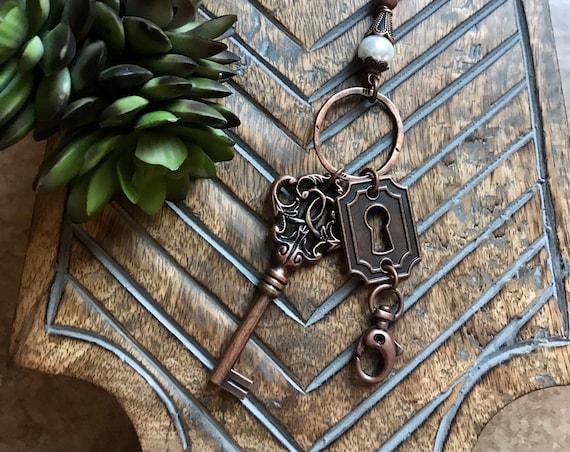 Long Pearl, Bronze Key, Bronze Lock Lanyard and Badge Holder