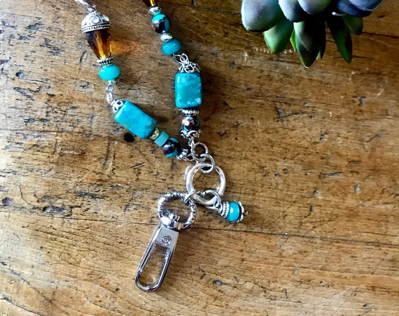 Turquoise, Silver and Amber colored Beaded Lanyard.
