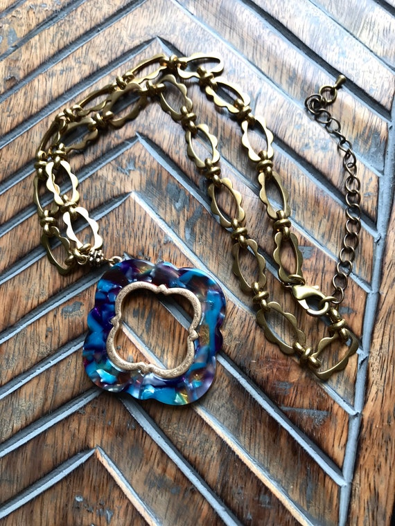 Dreamy Blue Pendant with Ornate Gold Chain