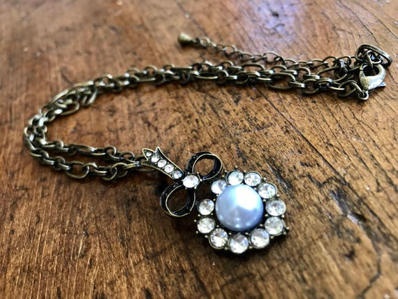 Bronze, Faux Pearl and Diamond short necklace.