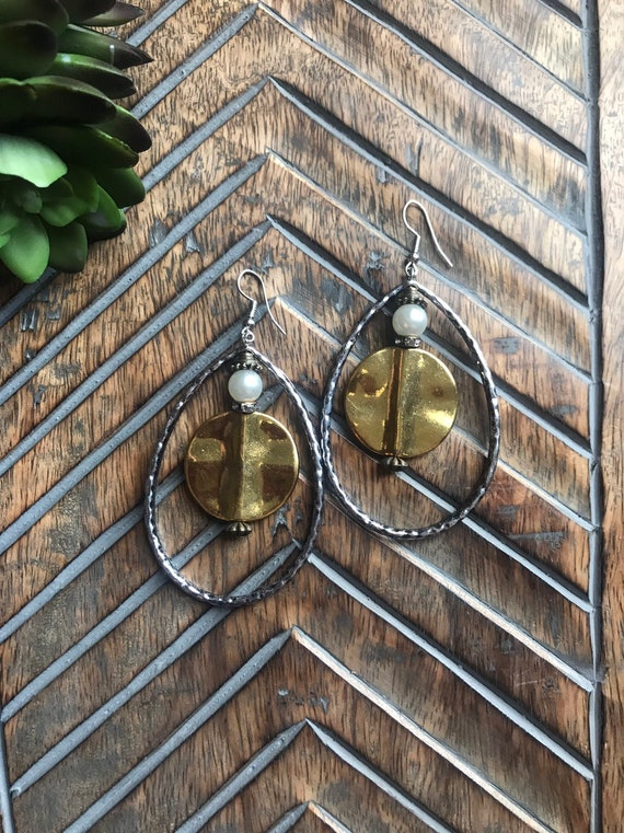 Large Silver Hoop and Gold Earrings.