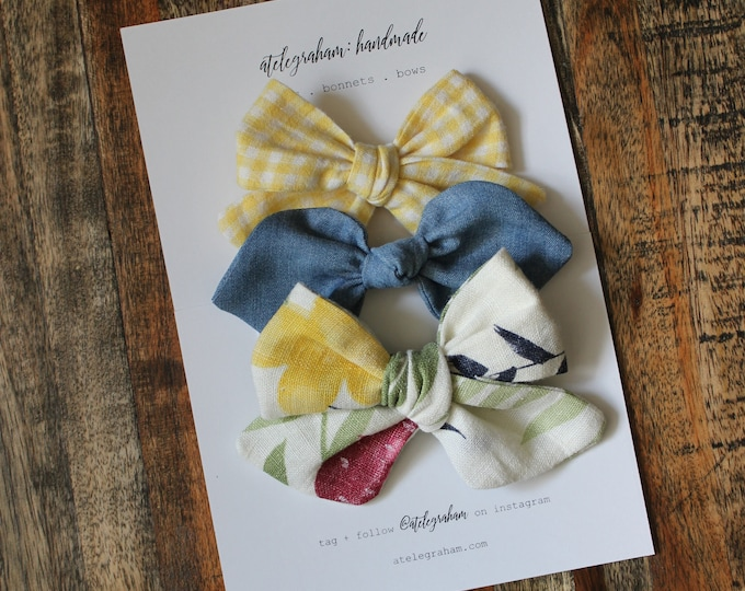 the july collection - handmade bows & headbands - made from high quality reclaimed material