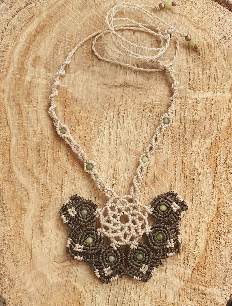 Macrame necklace in the shape of a floral half-mandala with jade beads