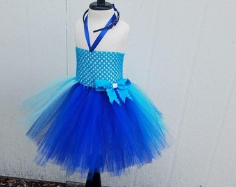 Turquoise and blue tutu with flower headband and bow on skirt