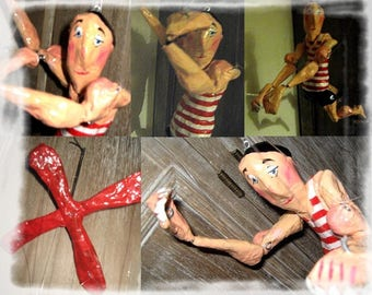 Articulated puppet. Multicolored paper