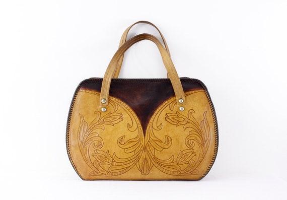 Art nouveau style tooled leather handbag, 1960s to