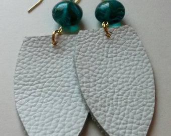 Bright white with teal glass bead.