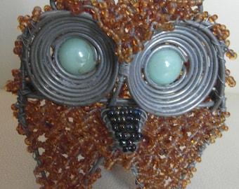 Eule in gold aus Massai-Perlen