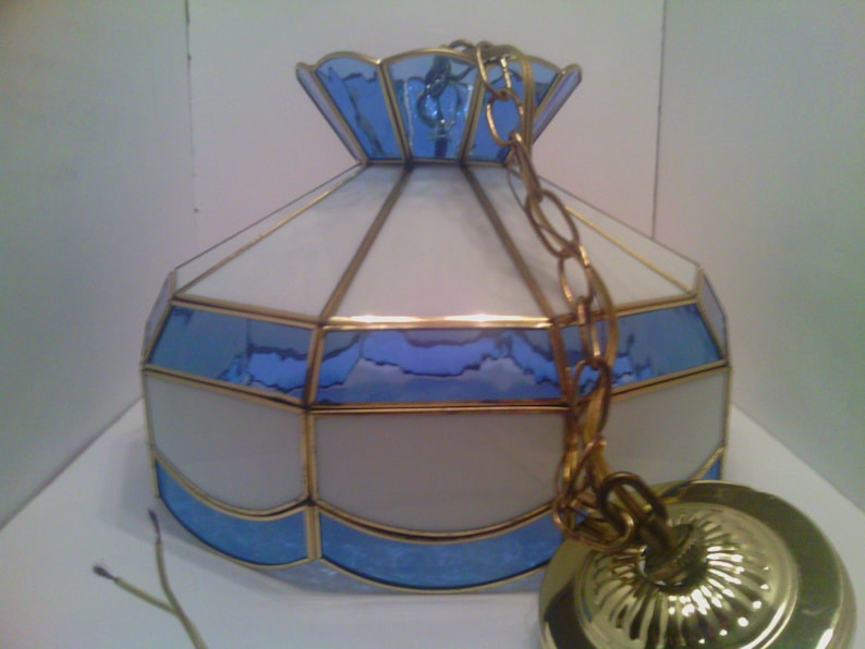 Vintage Blue And White Slag Glass Pendant Lamp Hangs From The Ceiling