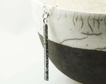 hammered and oxidised silver bar pendant, sweet chestnut bark necklace
