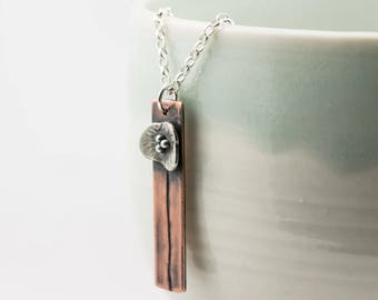 copper and silver poppy flower pendant necklace