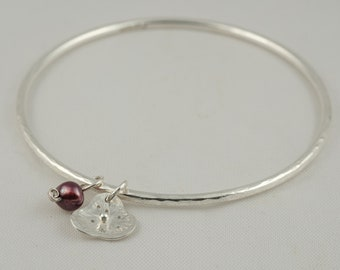 silver poppy flower and red freshwater pearl charm bracelet bangle