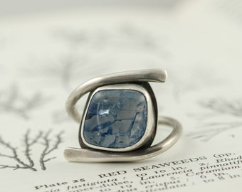 blue polished gemstone and silver statement band ring