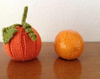 A hand knitted pumpkin to cover a Terry's chocolate orange. Ideal for Thanksgiving, Harvest or even Hallowe'en.