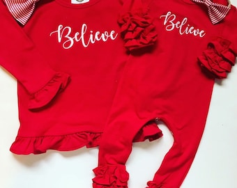3df30aa4a79 Girl sisters siblings matching Christmas outfits Baby girl ruffled  Christmas romper Believe