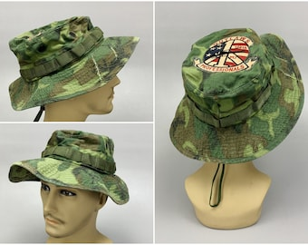 1960s Vintage Lime Green ERDL Jungle Camo Boonie Hat with 175th Aviation Company Outlaws Vietnam Peace Sign Helicopter Patch, Dated 1968