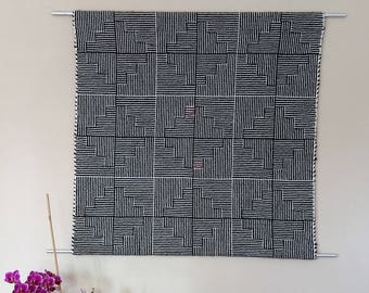Handwoven wall hanging pure wool in black and white with a blur of pink, shadow weave technique, splendid noise insulation