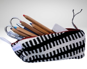 Finger woven black-white pencil case out of cotton lined, cosmetics bag closed by a zip fastener cotton