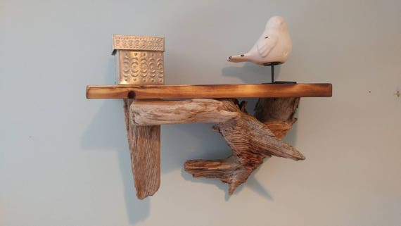 Handmade hanging shelf with cedar top and driftwood accents. Top shelf burned to give a more unique look.