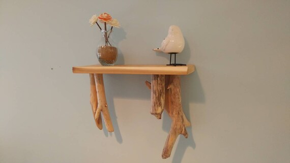 Handmade hanging shelf with cedar top and driftwood accents.