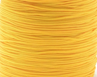 Polyester macrame thread 0.8mm golden yellow, slightly elastic, 10m wound on a spool