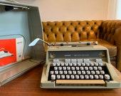 Working Hermes 3000 Typewriter with its original case and manual plus brush