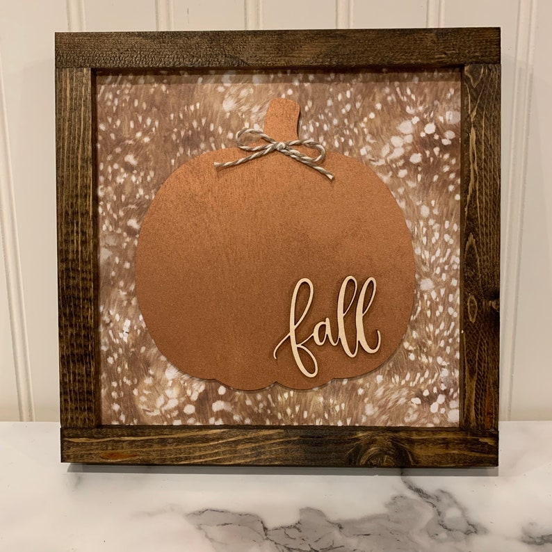 Rose Gold Pumpkin Sign with Faux Fur Background and Natural image 0
