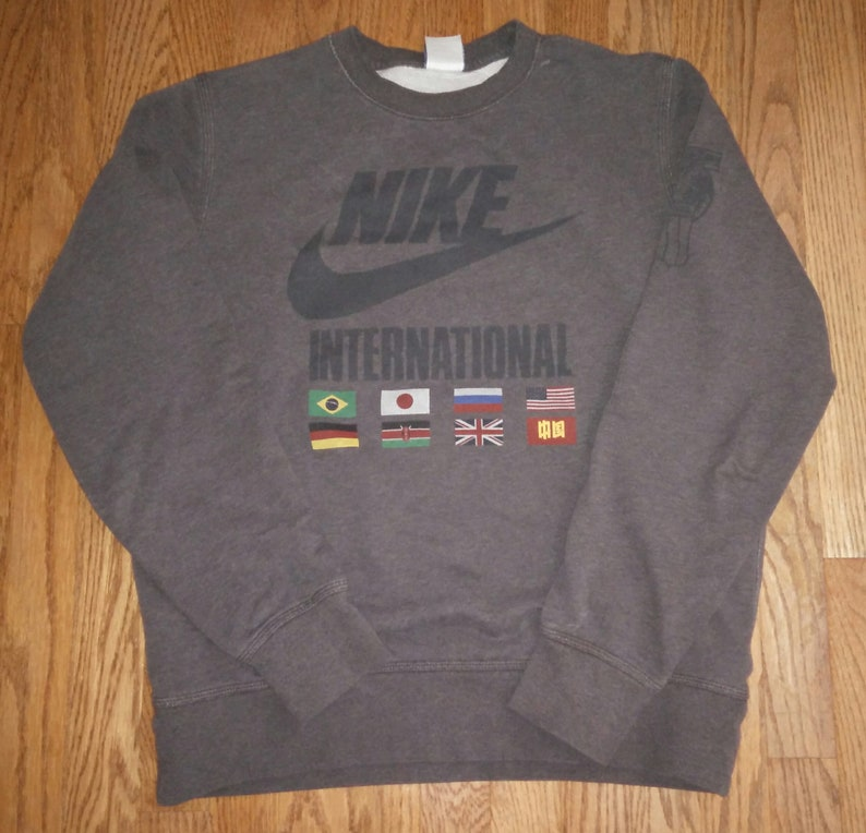 d52940183c9c Vintage Mens Nike International track and field sweater
