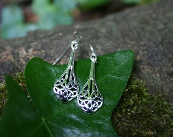 Long Trinity Knot Earrings With Sterling Silver