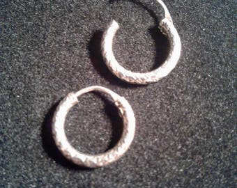 Sterling silver endless hoop earring