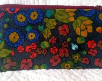 Flower print bag with blue ladybug charm