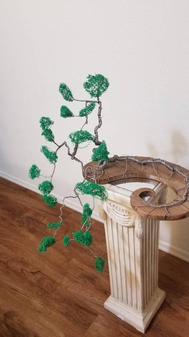 Cascading Bonsai Wire tree sculpture on Fibonacci spiral base