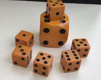 Butterscotch Amber Bakelite Gaming Dice - One Large And Six Small.
