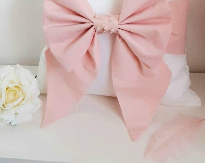 Blush Pink Pearl Bow Cushion