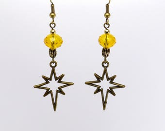 Star of brass and faceted yellow glass bead earrings.
