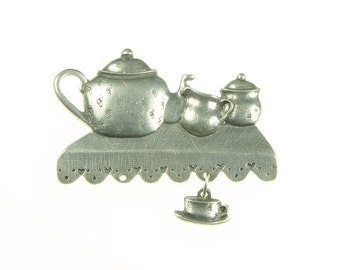 Teapot Theme Pin In Pewter By Danforth. Teapot, Creamer And Sugar On A  Shelf With A Dangling Teacup.
