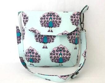 Crossbody Messenger Shoulder Handbag with magnetic clip closure,2 slip pockets and adjustable strap.