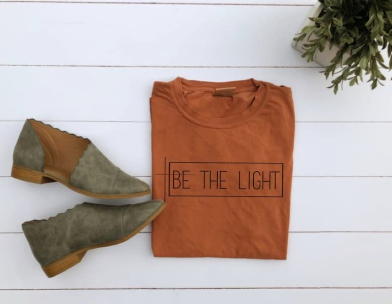 ON SALE Be The Light / Women's Christian Graphic Tee image 0