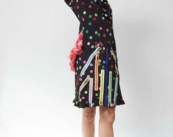 Edgy polka dot bustle dress