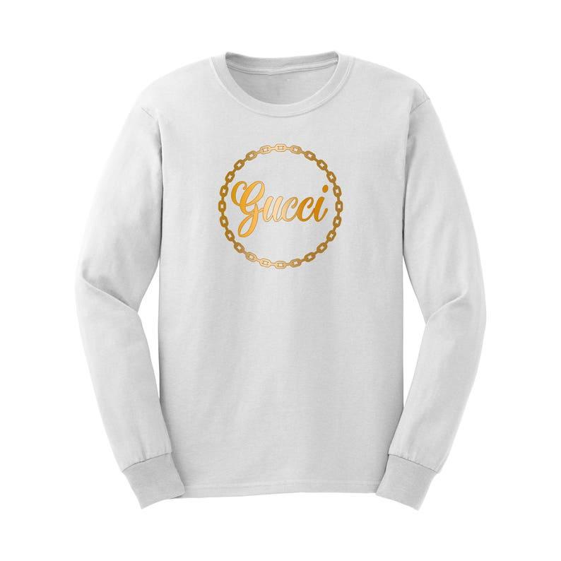 94cfbf1c0023 Gucci Unisex White Long Sleeve Shirt with Metallic Gold